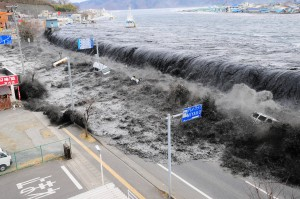 A wave approaches Miyako City from the Heigawa estuary in Iwate Prefecture